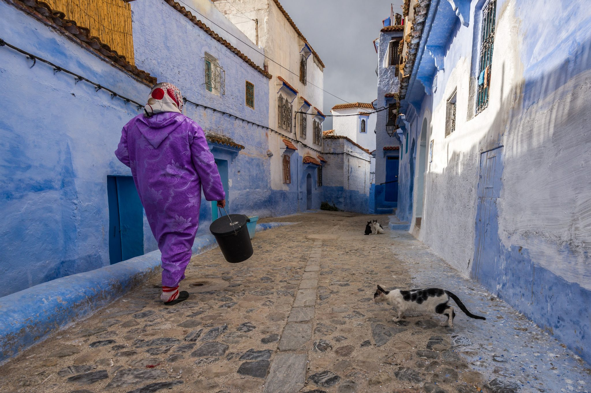 Morocco, Chefchouen, Woman Walking