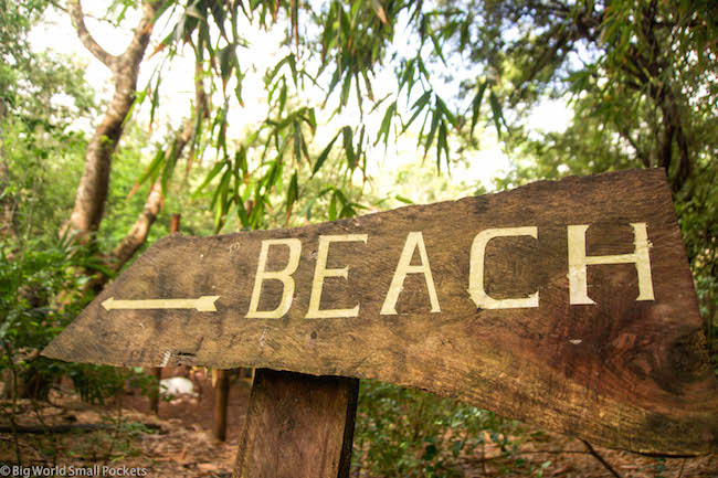 Kenya, Distant Relatives, Beach Sign