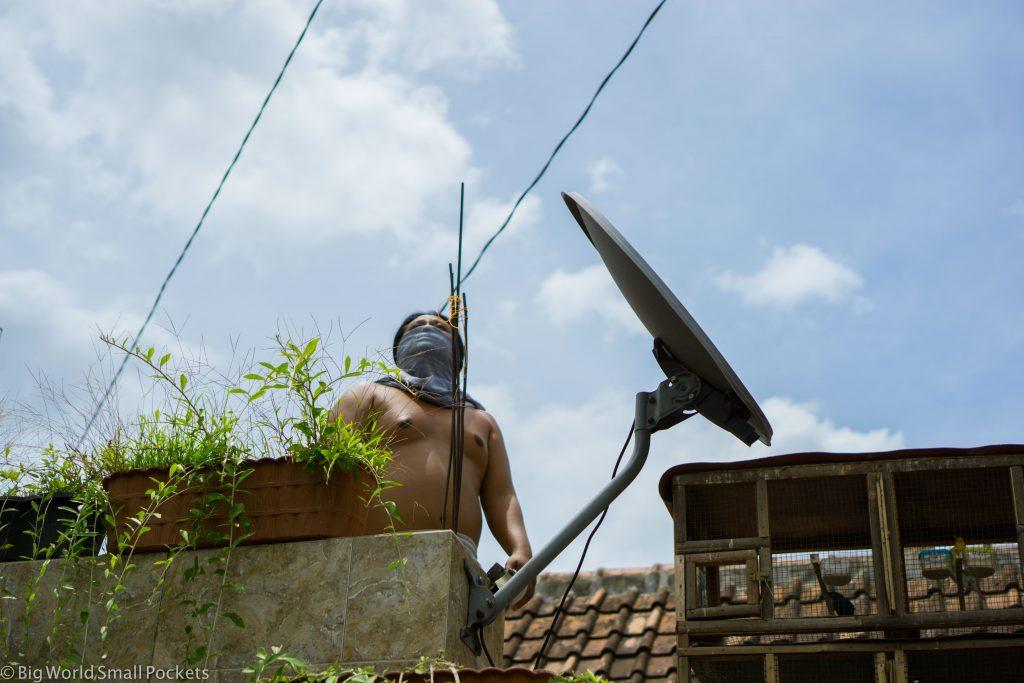 Indonesia, Yogyakarta, Man on Roof