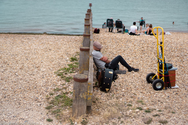 England, Whitstable Beach, Busker