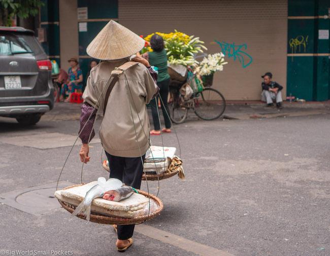 Vietnam, Hanoi, Man with Fish